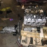4.8L LR4 iron-block Chevy V8 next to a Subaru transaxle five-speed