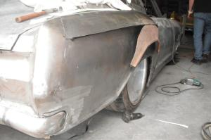 metal work being preformed on a 1964 Buick Riviera Rivision
