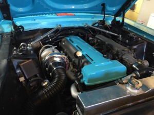 A single turbo 2JZ inside a 1968 Mustang engine bay