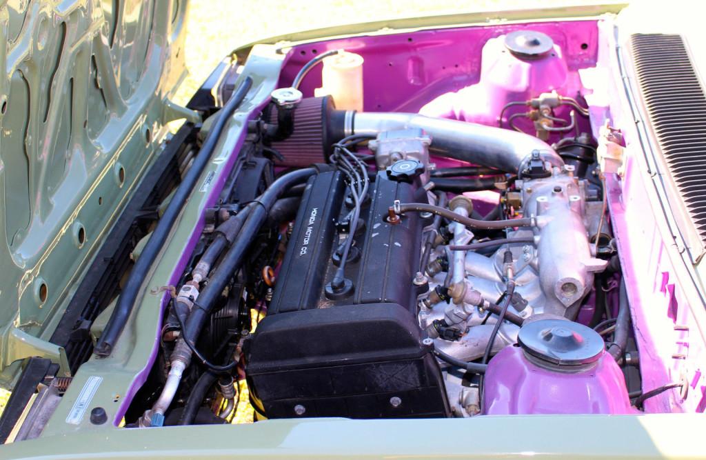 1996 Acura Integra B18b engine inside the engine bay of a 1983 Honda Civic wagon