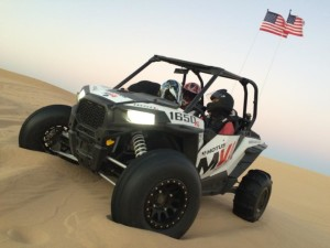 2015 Polaris RZR XP1000 with a Motus V4 swap kit being tested on the dunes
