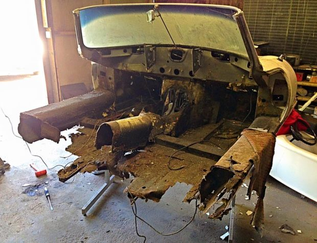 rusted Jaguar E-Type front piece