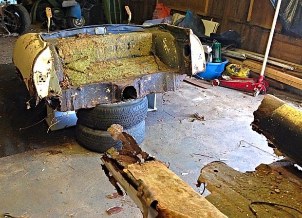 rusted Jaguar E-Type back piece