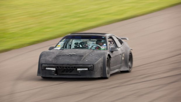 Matt Farah driving custom widebody 1986 Fiero with a turbo 4G63