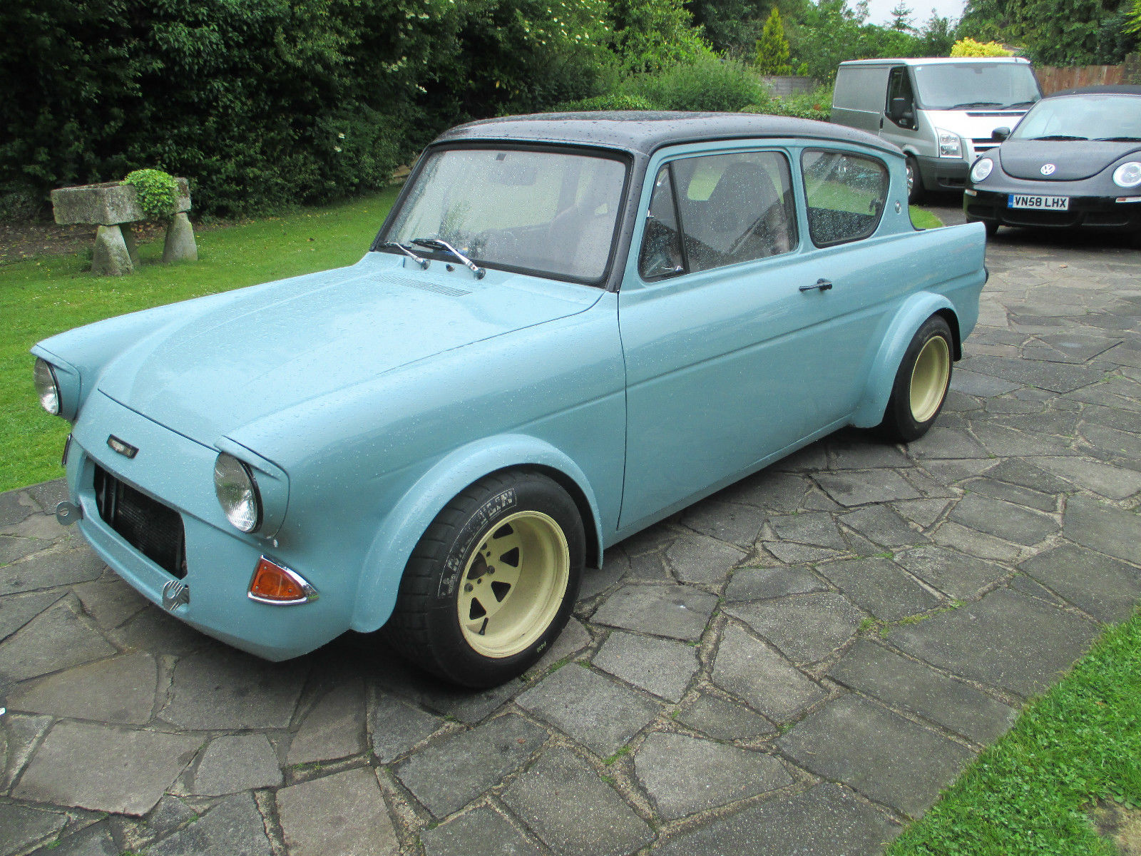 1967 ford anglia with a vauxhall red top