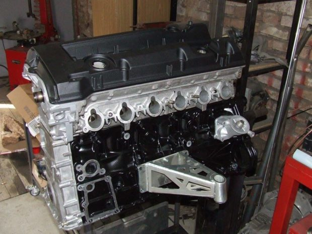 Mercedes M104 inline-six being prepped to go in a BMW E46