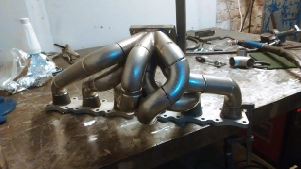 custom turbo exhaust headers for a Mercedes M104