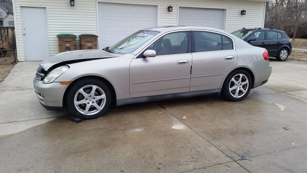 wrecked 2003 Infiniti G35 being used for parts