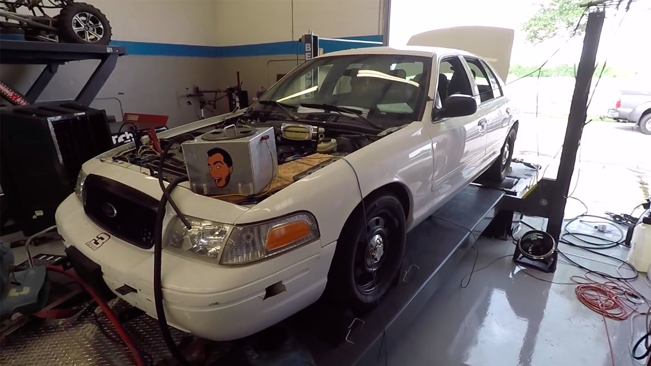 The goal to install a supercharged 5.4 L V8 and TR6060 six-speed manual  from a wrecked Mustang Shelby GT500 into a Ford Crown Victoria.