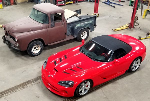 1956 Dodge truck next to a 2004 Dodge Viper