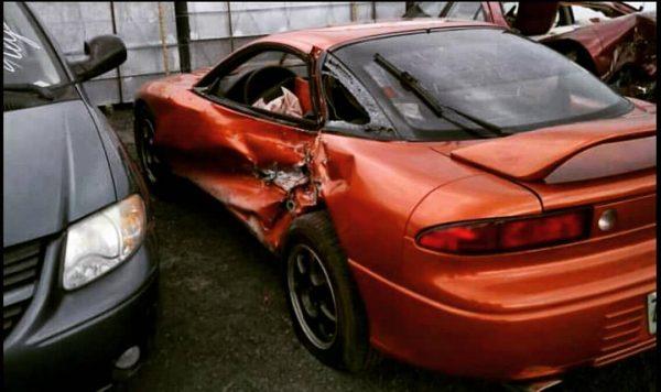 Mitsubishi 3000GT with side impact crash damage
