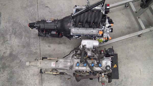 GM LSx V8 and 4L80E automatic transmission next to Toyota 2RZ-FE inline-four and automatic transmission