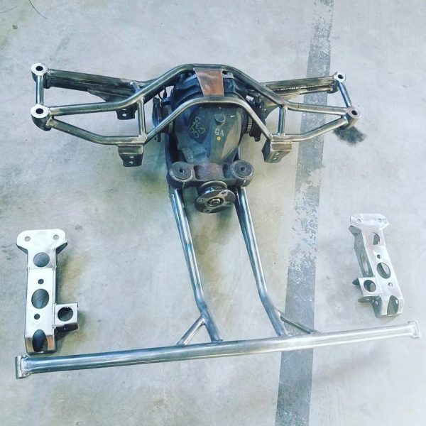custom tubular rear subframe to hold Nissan 350Z differential in a Subaru WRX
