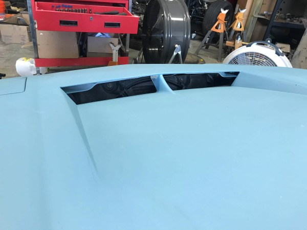 modified hood on a 1988 Pontiac Fiero built by Schwa Motorsports with a turbocharged VR6